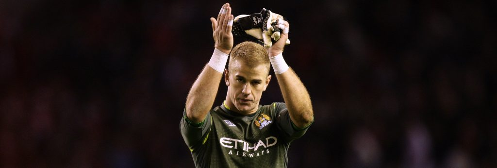 Manchester City's goalkeeper Joe Hart applauds supporters after his team's 1-1 draw against Liverpool in their English Premier League soccer match at Anfield Stadium, Liverpool, England, Sunday, Nov. 27, 2011. (AP Photo/Jon Super)