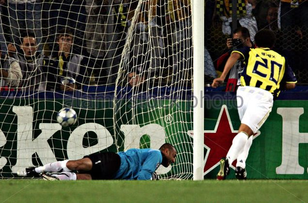 Fenerbahce's De Souza scores against PSV Eindhoven's goalkeeper Gomes from penalty spot during Champions League match in Istanbul